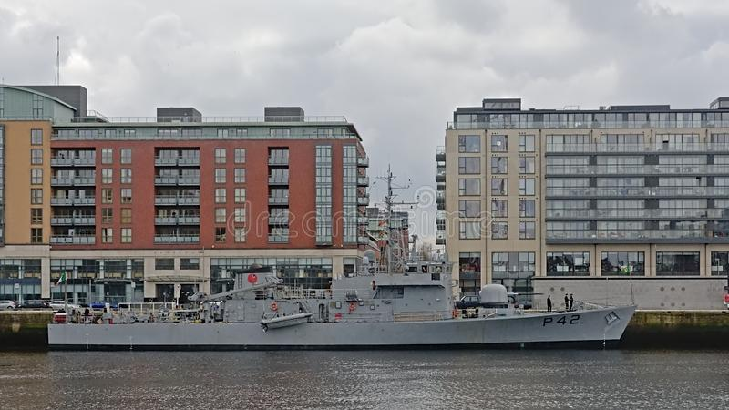 Military ship in fron to pqrtment buildings in the city of Dublin stock photography