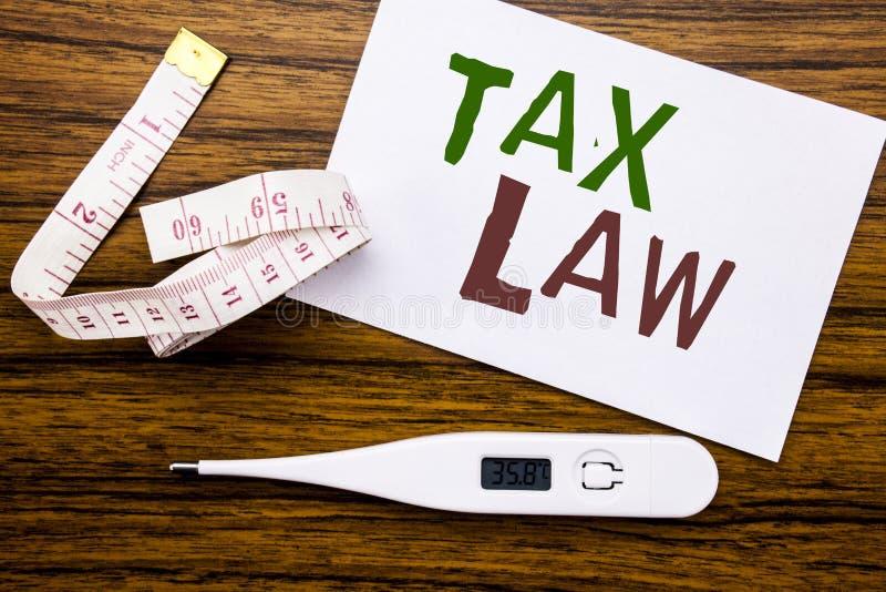 Légende conceptuelle des textes d'écriture de main montrant le droit fiscal Le concept d'affaires pour la loi fiscale d'impositio photo stock