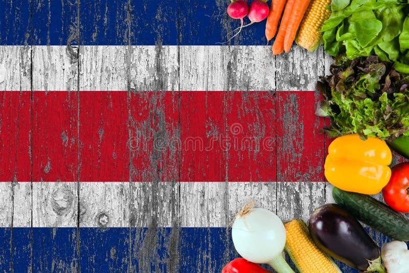 L?gumes frais de Costa Rica sur la table Cuisson du concept sur le fond en bois de drapeau image stock