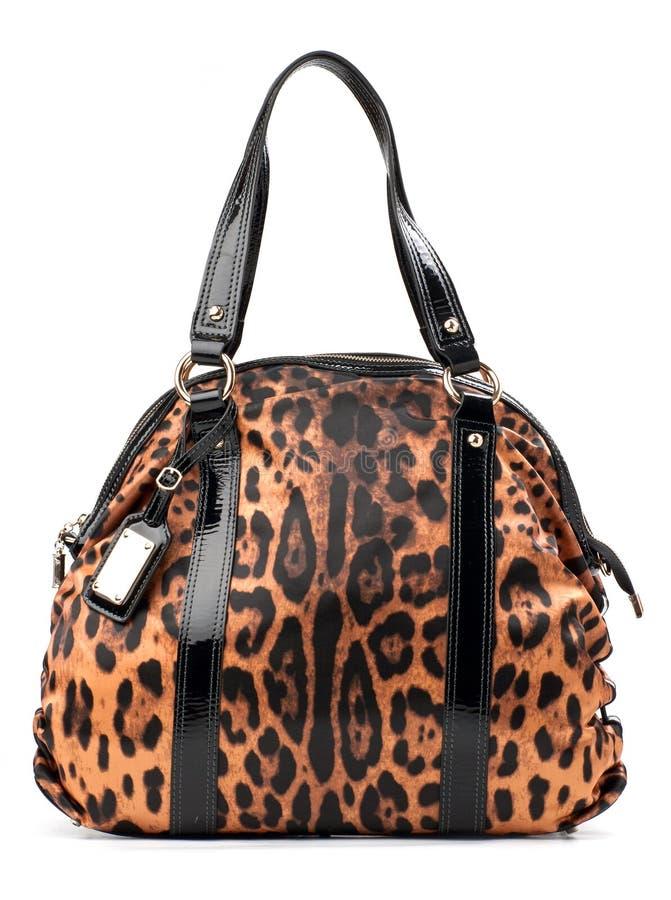 Léopard-estampez le sac d'épaule en cuir photo libre de droits