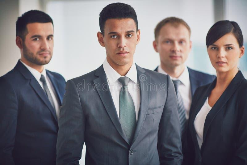 Líder de negócio e equipe fotografia de stock royalty free