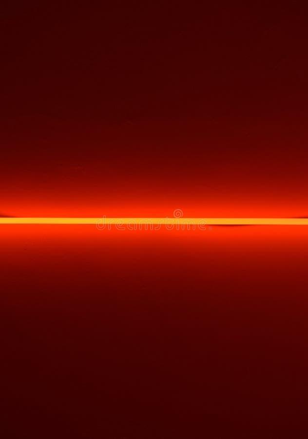 Línea de luz en fondo rojo fotos de archivo