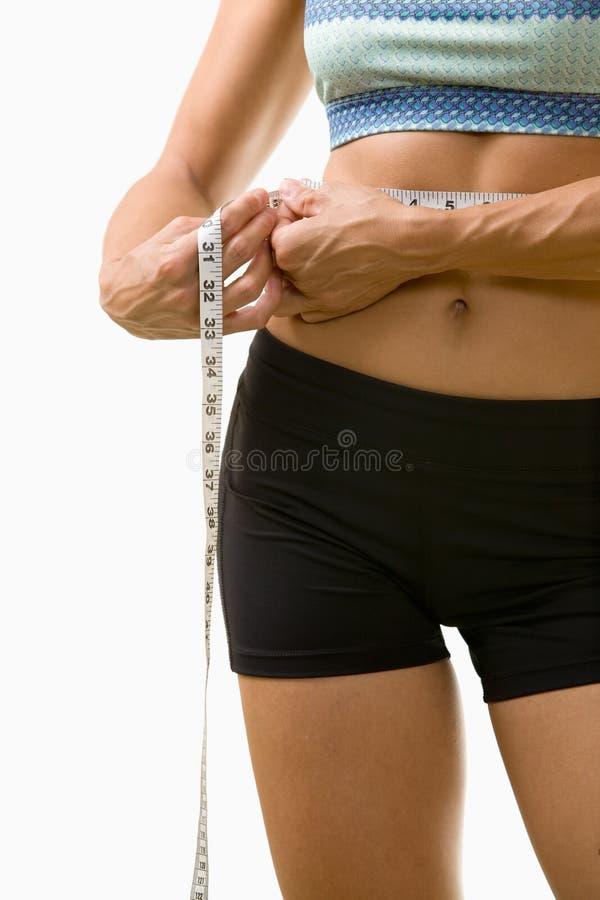 Línea de medición de la cintura imagen de archivo
