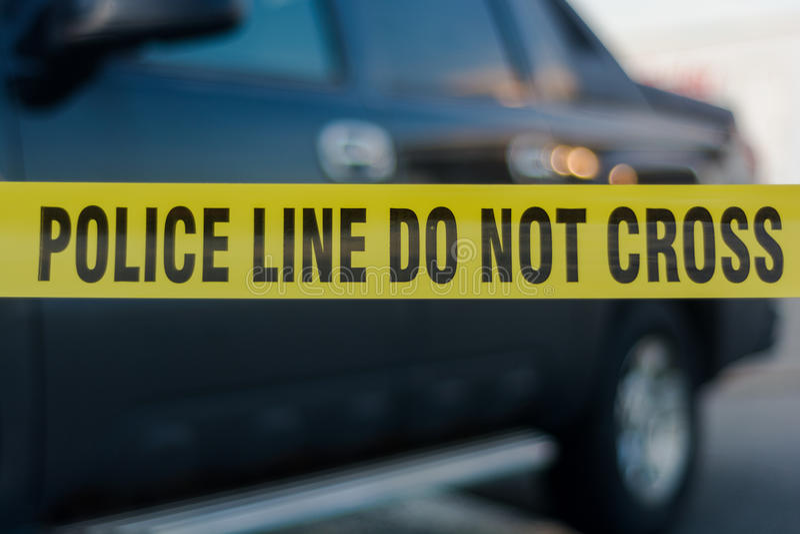 Línea de policía amarilla cinta foto de archivo libre de regalías