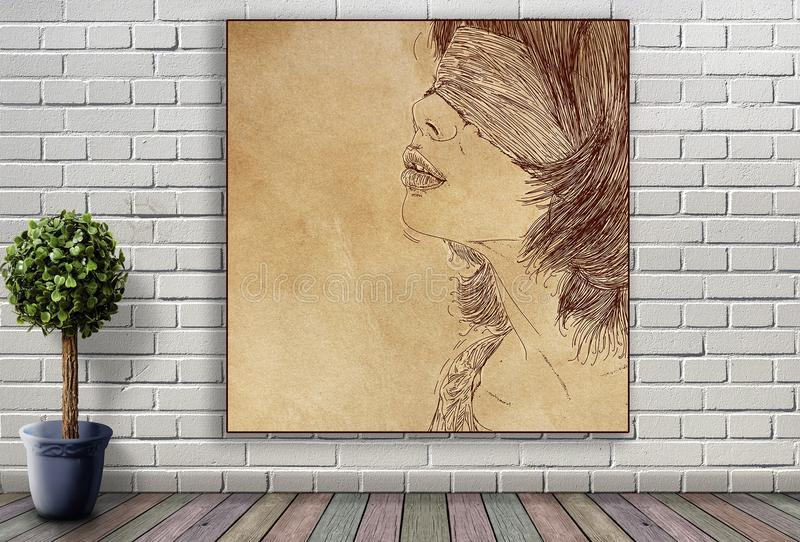 Línea retrato de mujer que cuelga en la pared de ladrillo foto de archivo