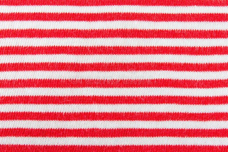 Línea roja y blanca horizontal vagos del modelo de la textura de la tela que hacen punto fotografía de archivo libre de regalías