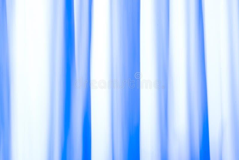 Líneas que fluyen del fondo abstracto de una cortina imagenes de archivo