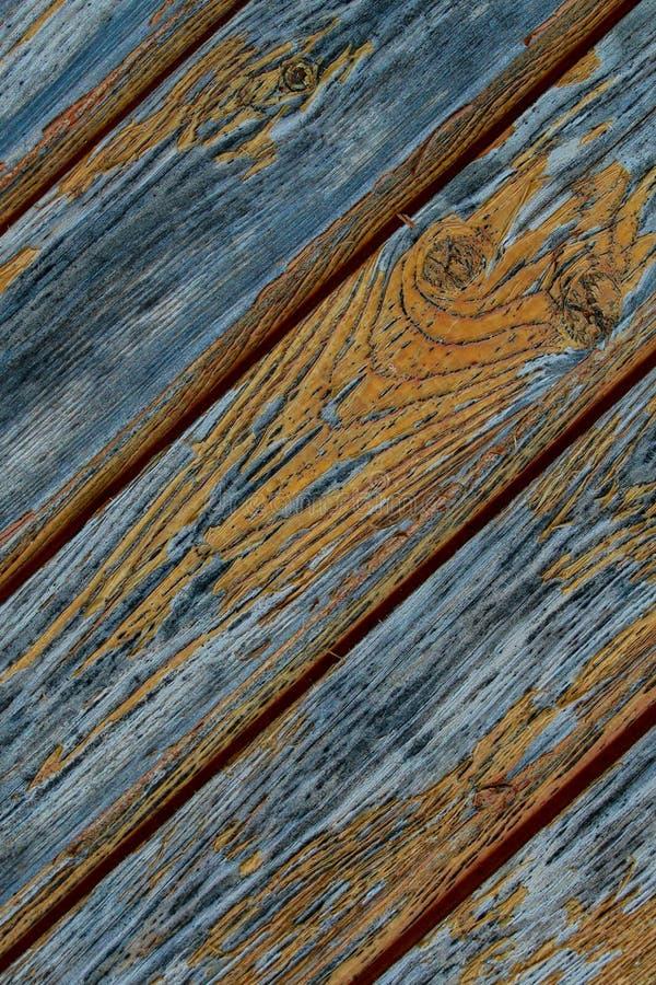 Líneas que se inclinan de los viejos tableros del panel que pelan el diseño anaranjado del grunge del fondo de la pintura paralel fotos de archivo