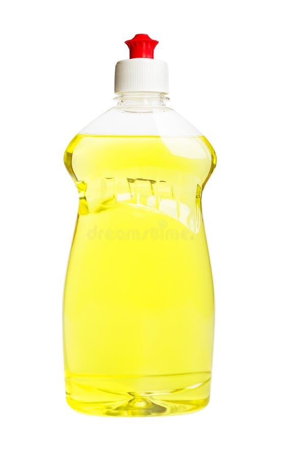 L?quido amarelo da lavagem da lou?a em uma garrafa pl?stica transparente isolada em um fundo branco Detergente da cozinha Produto fotografia de stock royalty free
