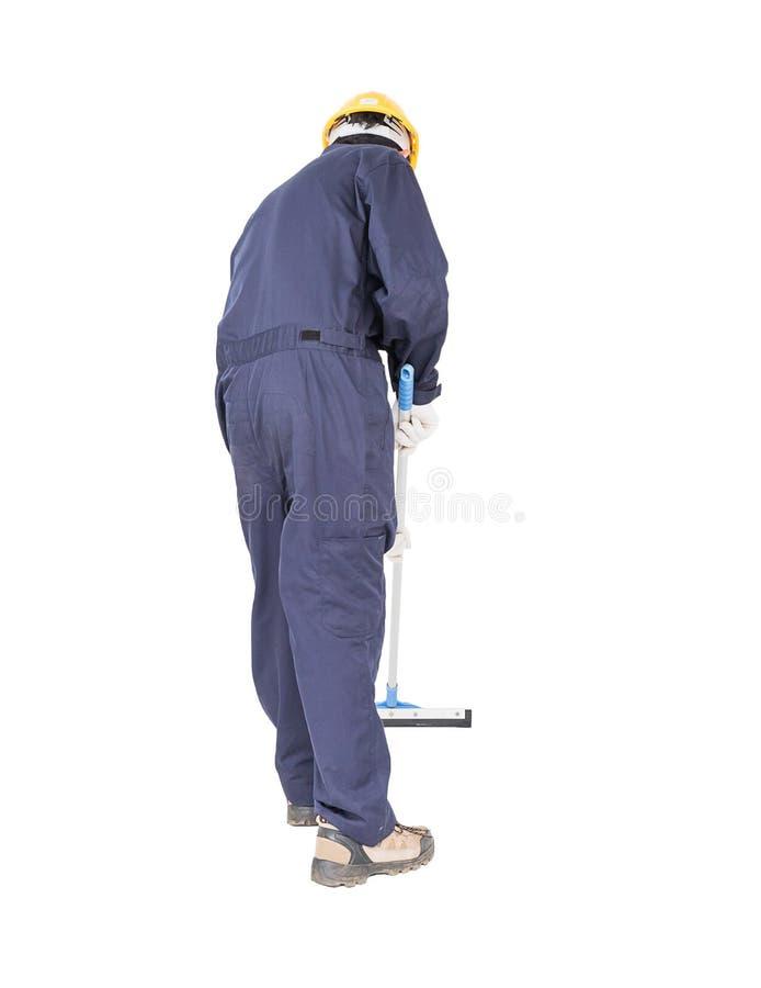 Líquido de limpeza de janela do rodo de borracha da posse do homem novo isolado no branco foto de stock