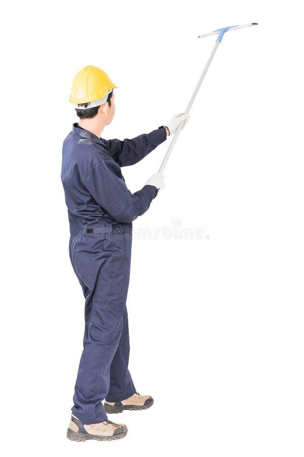 Líquido de limpeza de janela do rodo de borracha da posse do homem novo isolado no branco fotos de stock