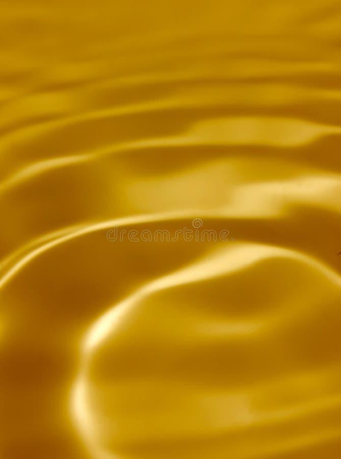Líquido de oro foto de archivo libre de regalías