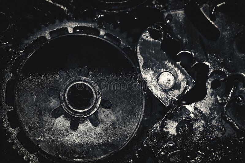 Líquido en la máquina sucia de los engranajes foto de archivo