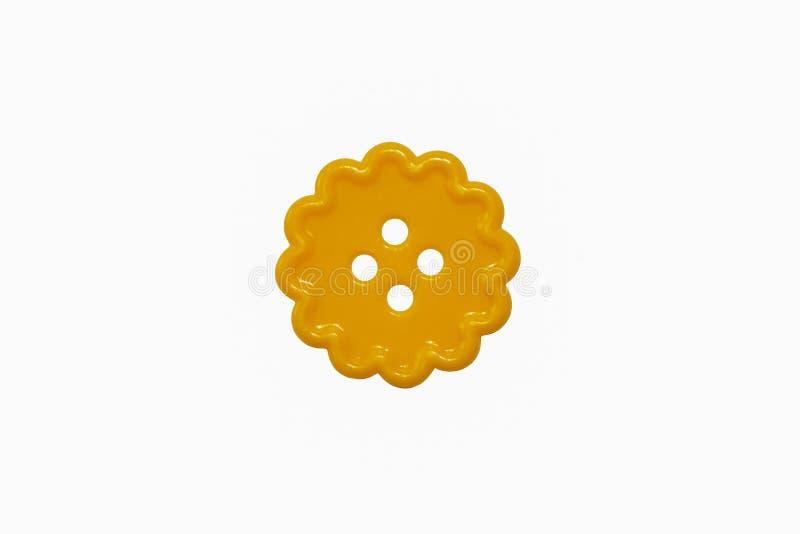 Löcher eines Knopfes vier der runden Locke gelbe nähende stockfoto