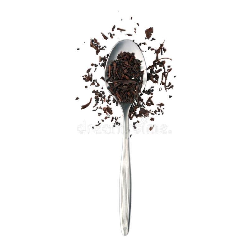 Löffel mit schwarzem Tee stockbilder