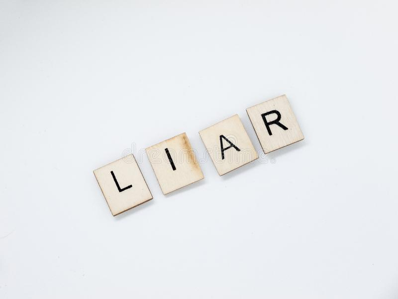 Lögnareträbokstäver royaltyfria bilder