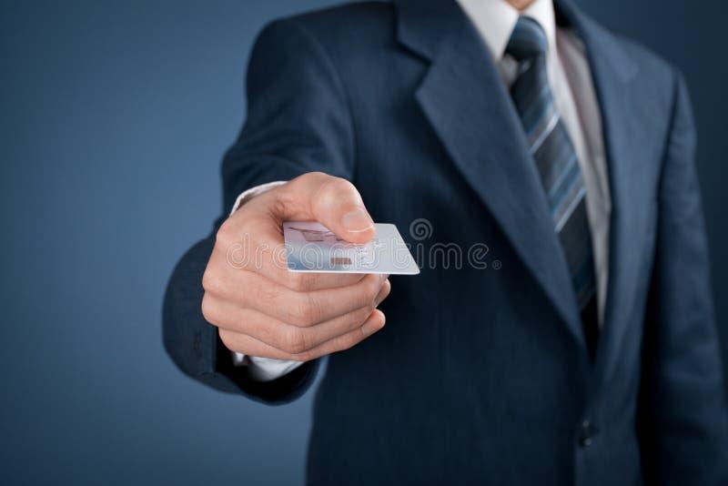 Lön vid kreditkorten arkivfoto