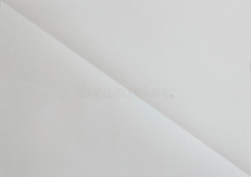 Löschen Sie diagonaly gefaltetes Blatt Papier Konzept für Hintergrund lizenzfreie stockfotos