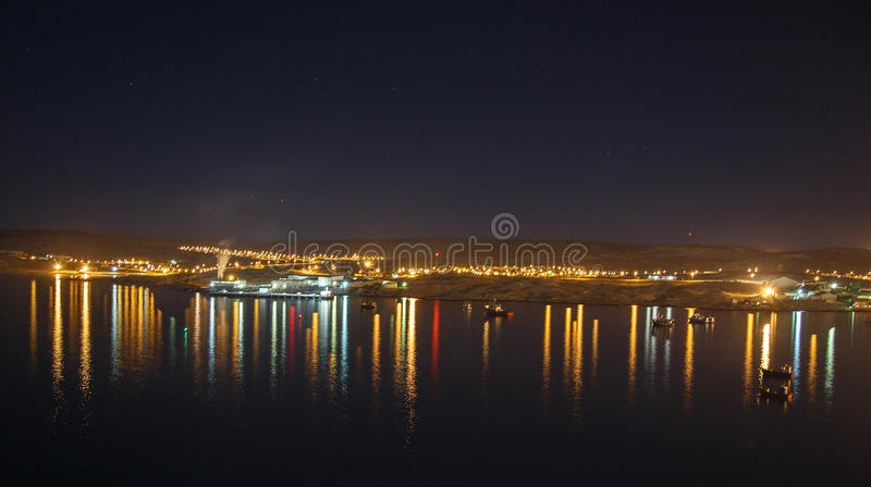 Lüderitz harbour lights. Lüderitz is a harbour town in southwest Namibia, lying on one of the least hospitable coasts in Africa. It is a port developed stock photos