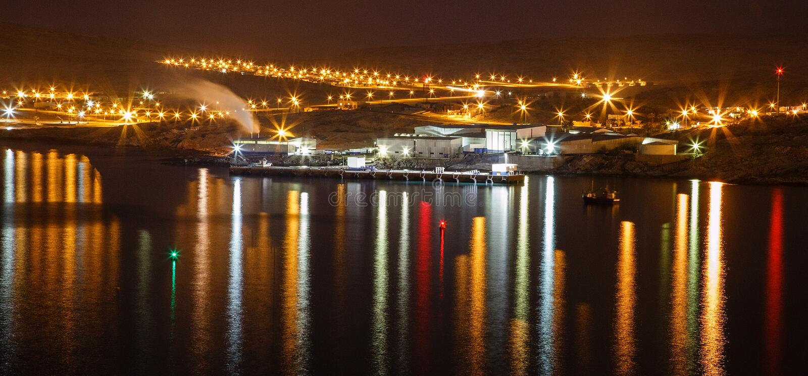Lüderitz harbour lights. Lüderitz is a harbour town in southwest Namibia, lying on one of the least hospitable coasts in Africa. It is a port developed royalty free stock photography