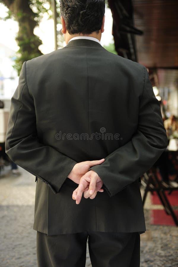 Lügner: Geschäftsmann mit den Fingern gekreuzt stockbilder
