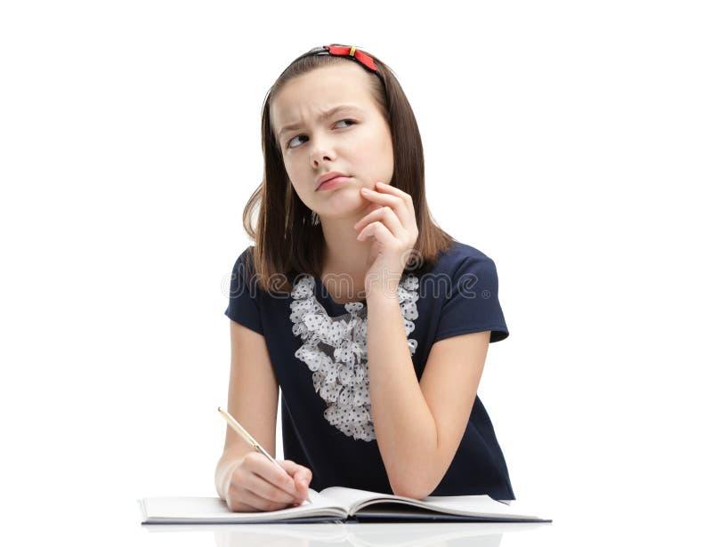 L'écolière pense plus de photographie stock