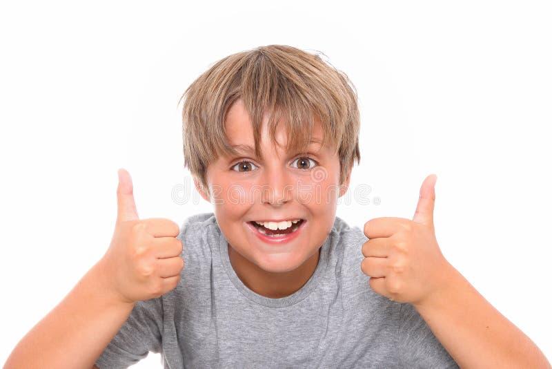 L'écolier de bonheur affiche NORMALEMENT photo stock