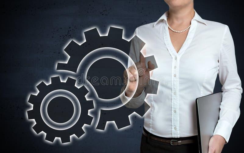 L'écran tactile de vitesse est montré par la femme d'affaires photos libres de droits