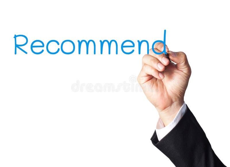 l'écriture de main recommandent sur le conseil blanc photos stock