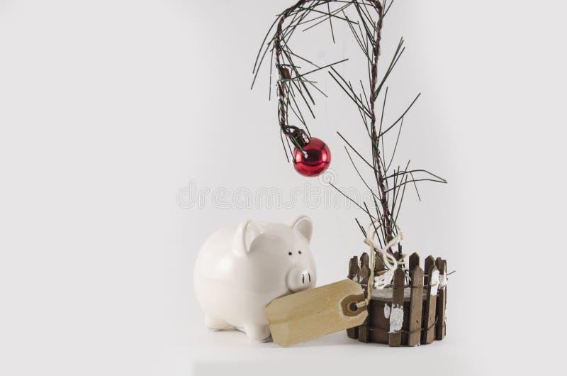 L'épargne et dépense de Noël photo libre de droits