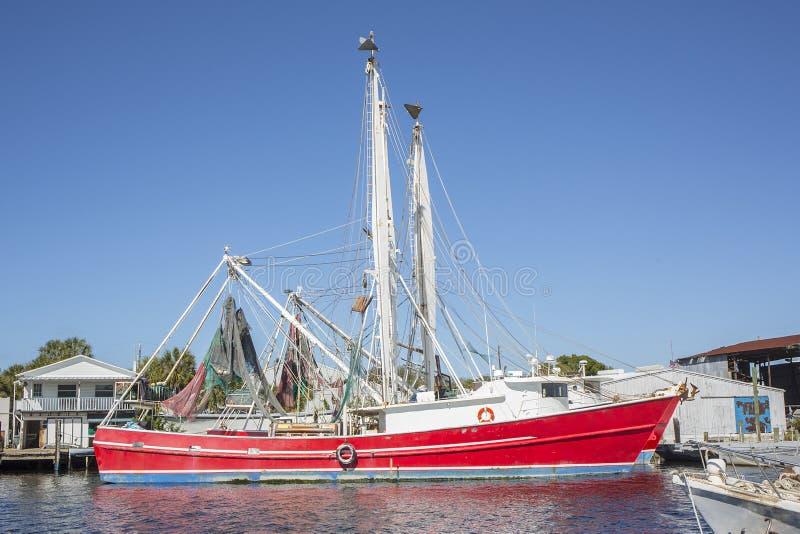 L'éponge accouple le bateau commercial image libre de droits