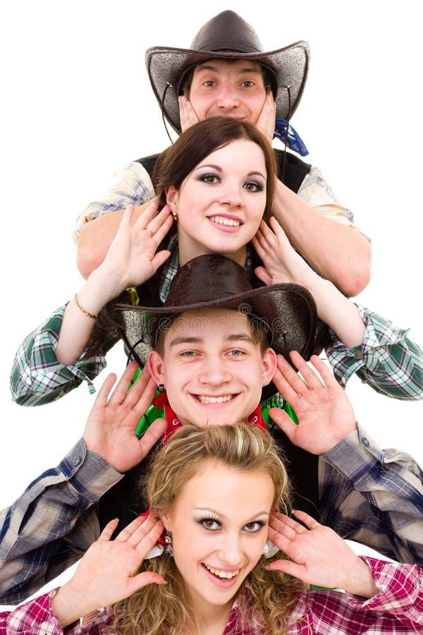 Équipe de danseur de cabaret habillée dans des costumes de cowboy photos libres de droits
