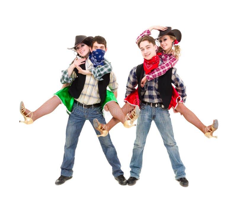 Équipe de danseur de cabaret habillée dans des costumes de cowboy image libre de droits