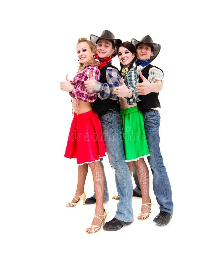 Équipe de danseur de cabaret habillée dans des costumes de cowboy photographie stock