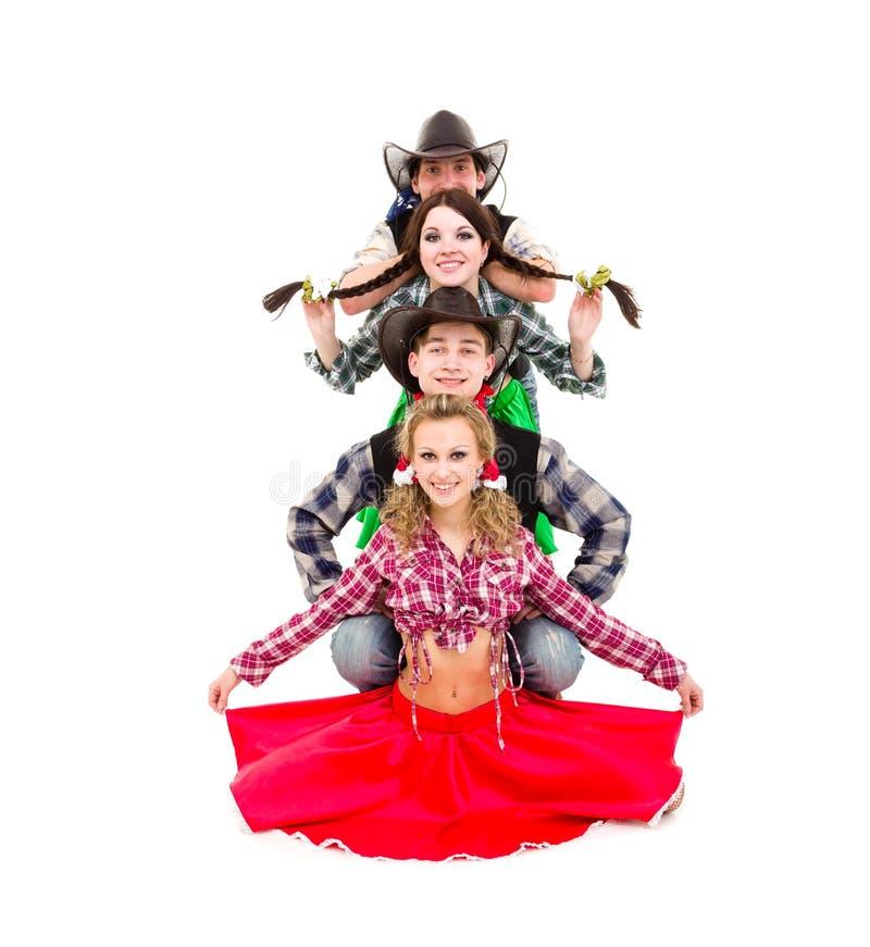 Équipe de danseur de cabaret habillée dans des costumes de cowboy photo libre de droits