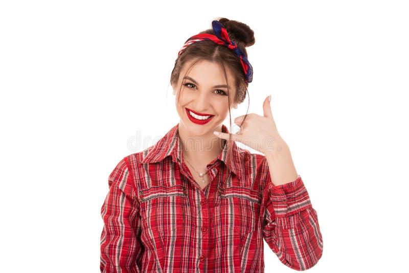 L'étudiant heureux enthousiaste de femme faisant l'apparence m'appellent signe de geste photographie stock libre de droits