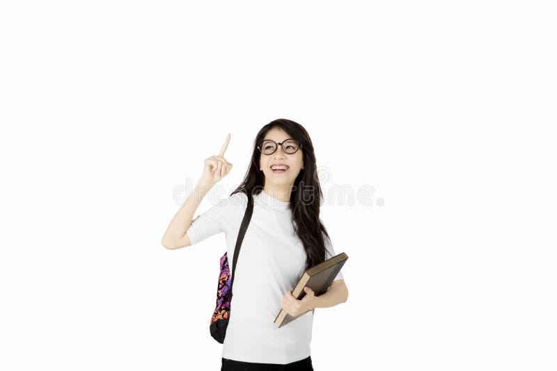 L'étudiant universitaire féminin asiatique a l'idée photo libre de droits