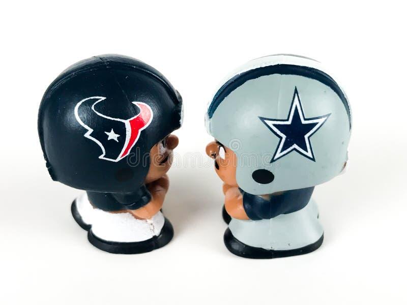 ` L товарищи по команде Collectibles Li забавляется, Texans v Ковбои стоковая фотография