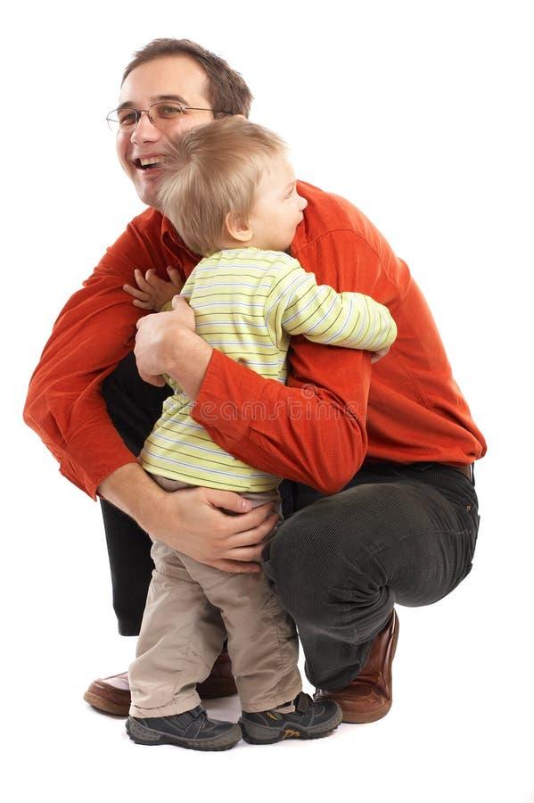 L'abbraccio - padre e figlio fotografia stock