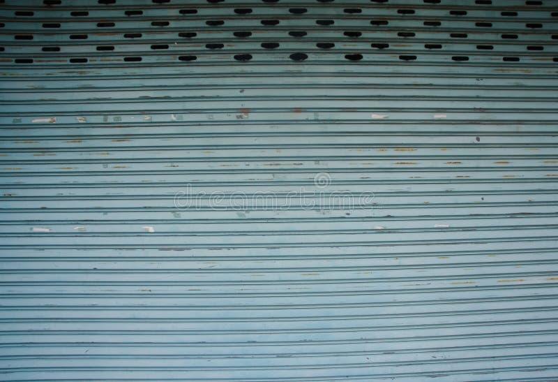 L'acciaio inossidabile rotola in su il portello fotografia stock