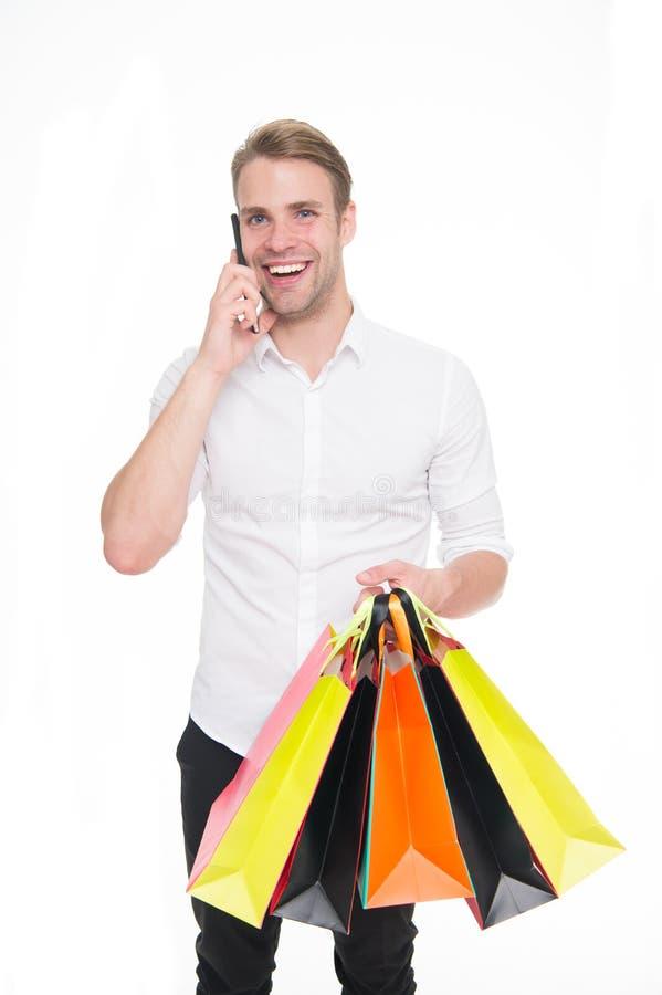 L'achat de type vêtx en ligne Concept en ligne d'achats La prise favorise des achats et la livraison en ligne Appel d'homme pour  photo libre de droits
