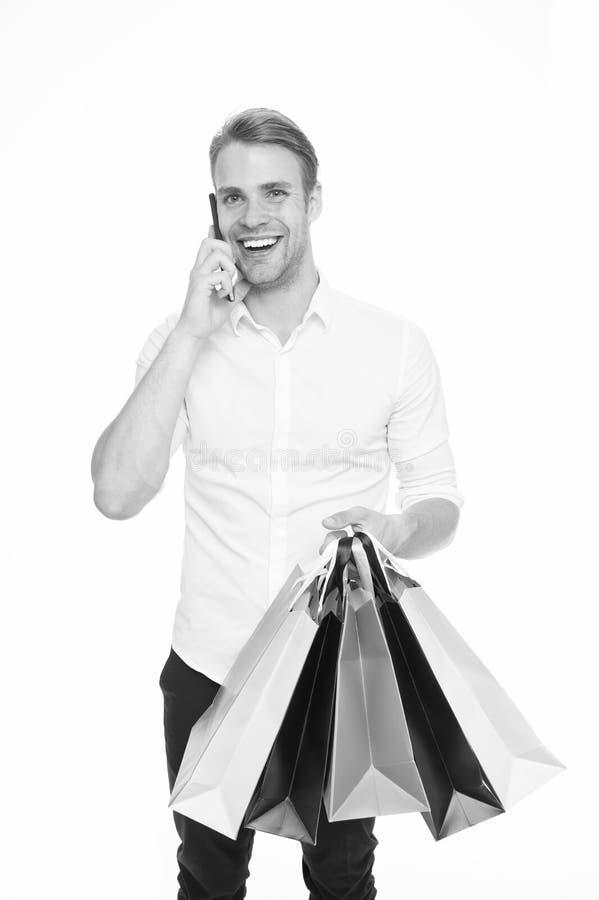 L'achat de type vêtx en ligne Concept en ligne d'achats La prise favorise des achats et la livraison en ligne Appel d'homme pour  images stock