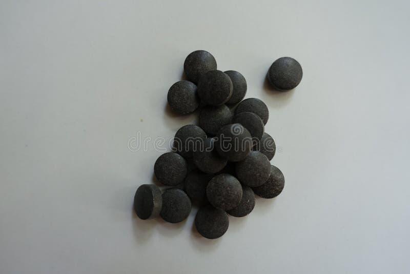 L'acide aminé a chélaté les pilules noires de fer photos libres de droits