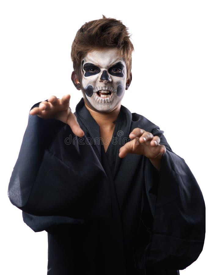 L'ado avec le cap de crâne de maquillage veut le grippage photo libre de droits