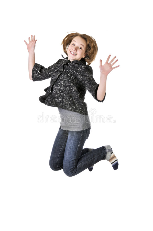 L'adolescente che salta sulla priorità bassa bianca fotografia stock