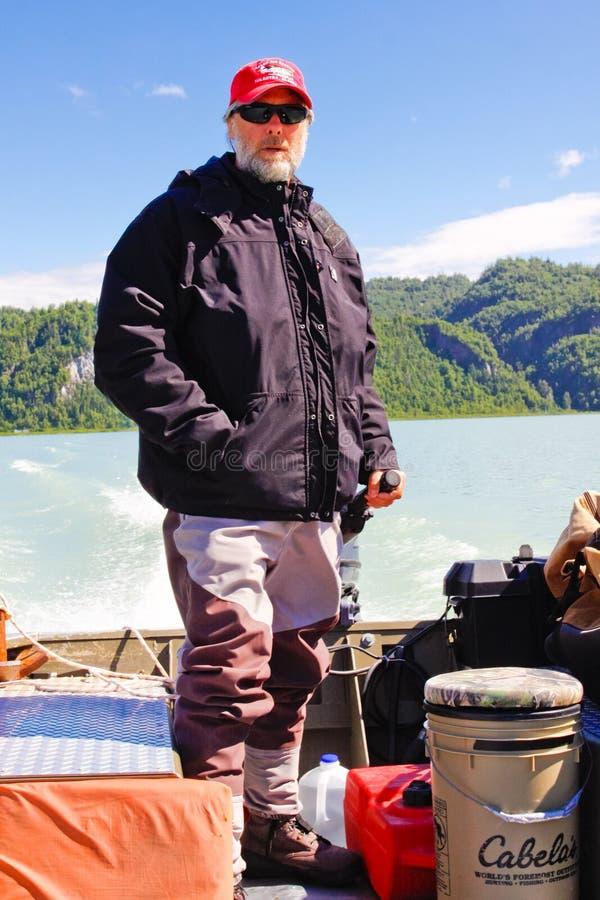 l'Alaska - bateau courant de guide de pêche photos stock