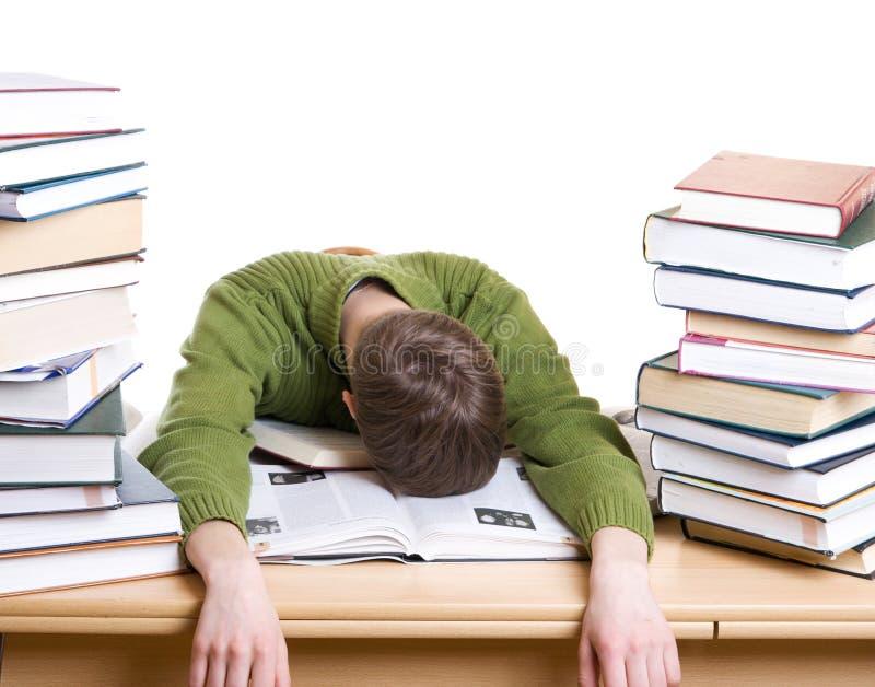 L'allievo addormentato con i libri isolati fotografia stock