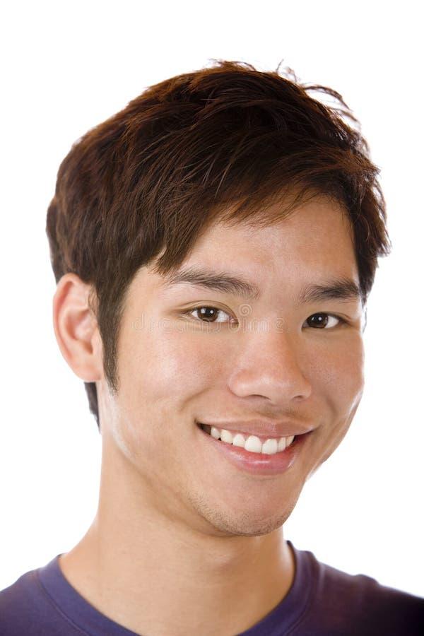 L'allievo asiatico felice è sorridere sicuro fotografia stock libera da diritti
