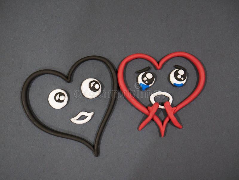 L'amour n'aime pas Larmes de bonheur Coeur de pâte à modeler images stock