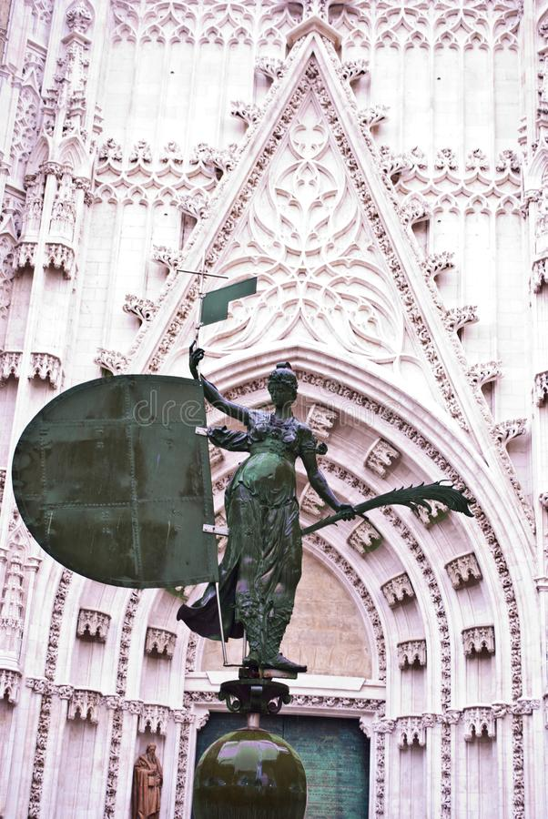 L'ange de la montre de supports de Séville photo libre de droits